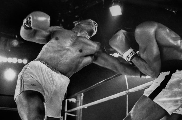 Lori Grinker's Mike Tyson Portfolio (Edition 5/10)  All 10 prints were produced in 2016 and signed by Mike Tyson and Lori Grinker. The portfolio presentation box also includes a colpholon signed by Tyson and Grinker.  7 black & white photographs, 16