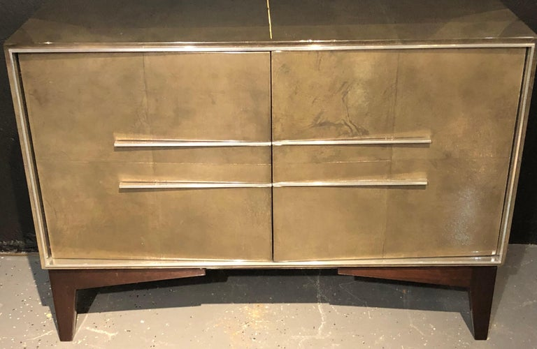 Lorin Marsh Designs Tuxedo two-door cabinet. New York 2000s. Lacquered gunmetal and parchment with Polished steel design. Two doors concealing four interior walnut drawers. Finished back. This chest retails for $18,750 in a lesser Lacquered finish.