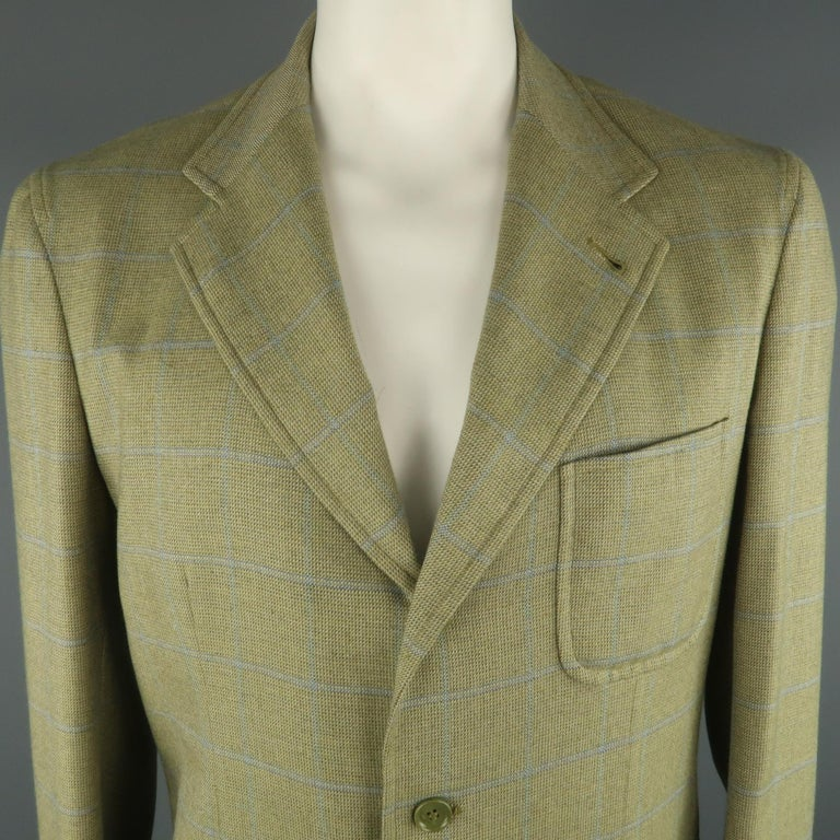 LORO PIANA Sport Coat comes in green and blue tones in a plaid cashmere material, with a notch lapel, patch pockets, 3 buttons at closure, single breasted, double vent at back, unlined. Made in Italy.   Excellent  Pre-Owned Condition. Marked: IT