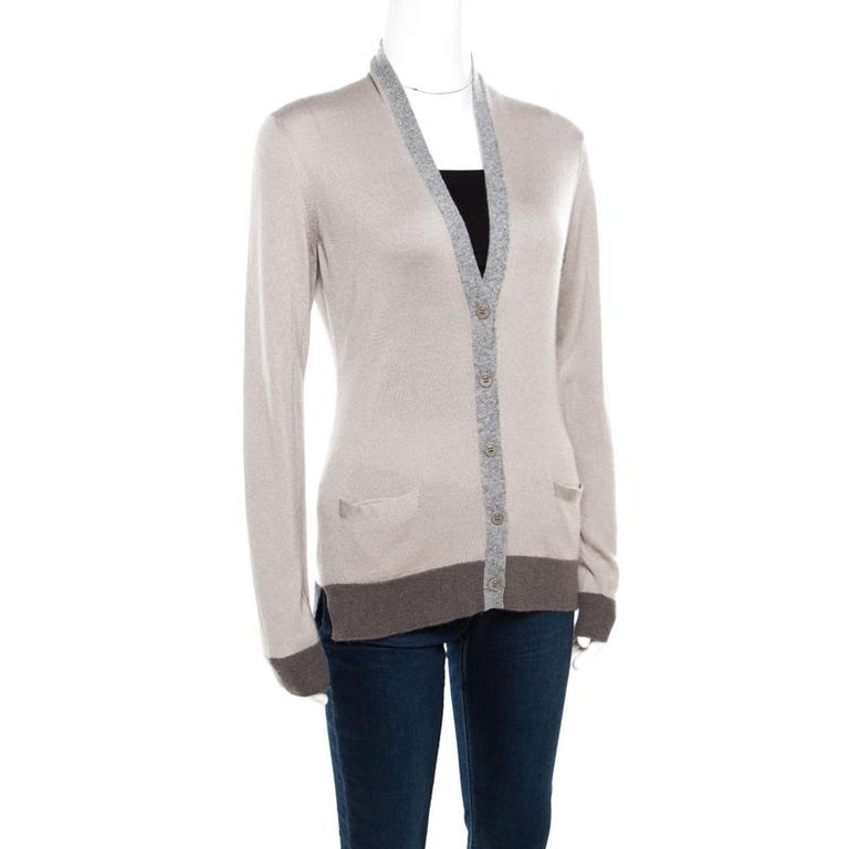 This cardigan from Loro Piana is one item your closet will love. Made from cashmere and silk, it has full sleeves, contrast rib trims, and full front buttons. Cut into a style that is feminine and stylish, this number is a must-buy.  Includes: The
