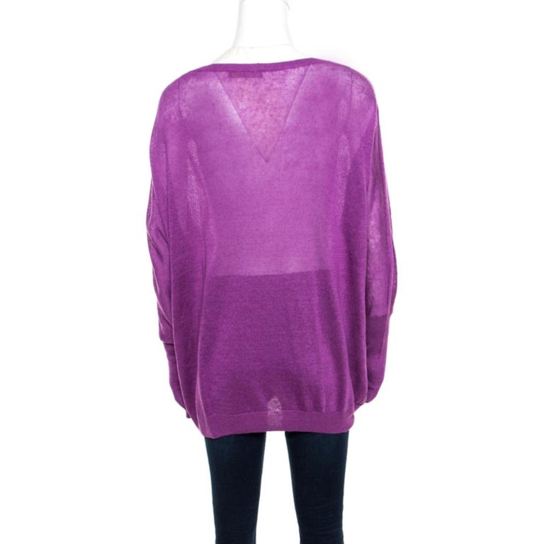 Simple and sophisticated, this sweater from Loro Piana definitely needs to be on your wishlist! The purple creation is made of a linen and silk blend and features a relaxed silhouette. It flaunts a wide neckline and long sleeves. Pair it with denims