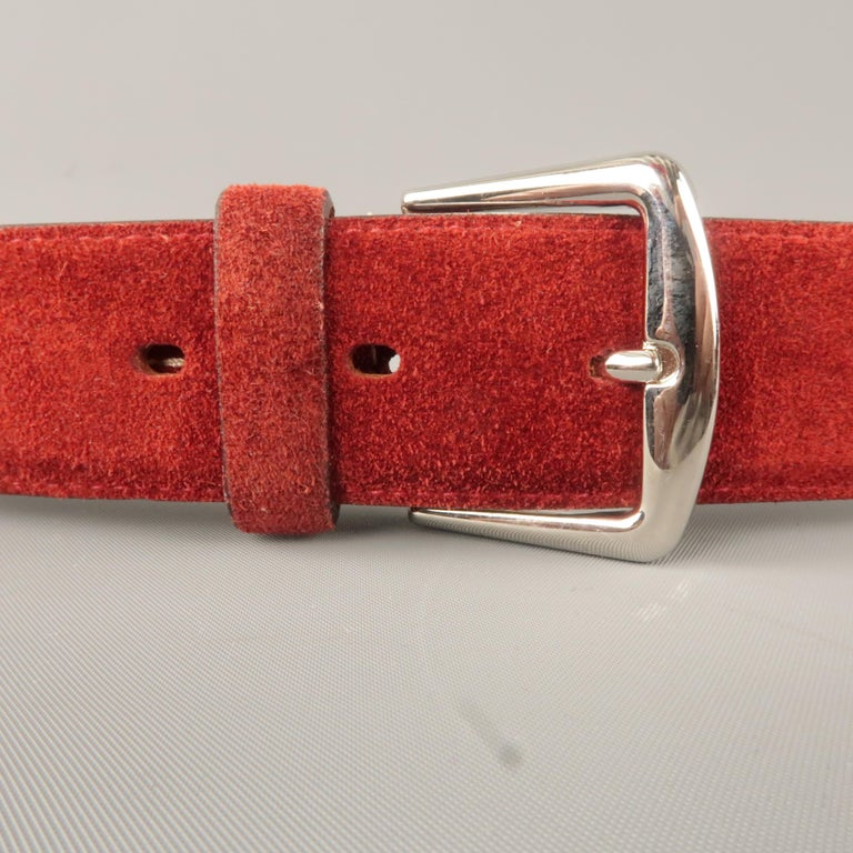 LORO PIANA belt comes in a maroon suede featuring a sliver tone buckle. Made in Italy.   Original Retail Price: $550.00 Very Good Pre-Owned Condition. Marked: 105/42   Length: 47 in. Width: 1.5 in. Fits: 38 - 42 in. Buckle: 1.5 in.