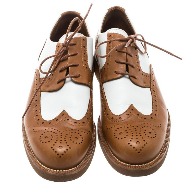 These Oxfords from Loro Piana are classy and stylish enough to grab you all the compliments! They are crafted from two-tone leather and feature a brogue design. They flaunt round toes and lace-ups on the vamps. They are equipped with comfortable