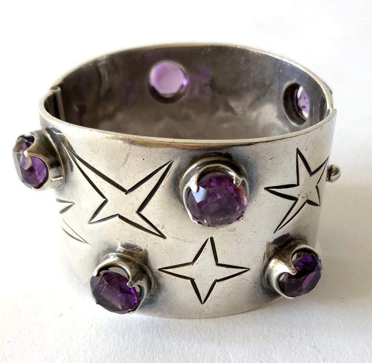 Sterling silver and amethyst hinged cuff bracelet created by Los Ballesteros of Taxco, Mexico.  Bracelet measures 1 3/4