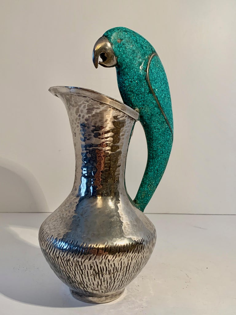 Los Castillo silver plate pitcher with parrot handle in turquoise. Useful as a pitcher, however, equally stunning as a decorative piece. For the Sophisticated bar, the parrot lover or to water your plants! From Mexico by Taxco of Mexico.