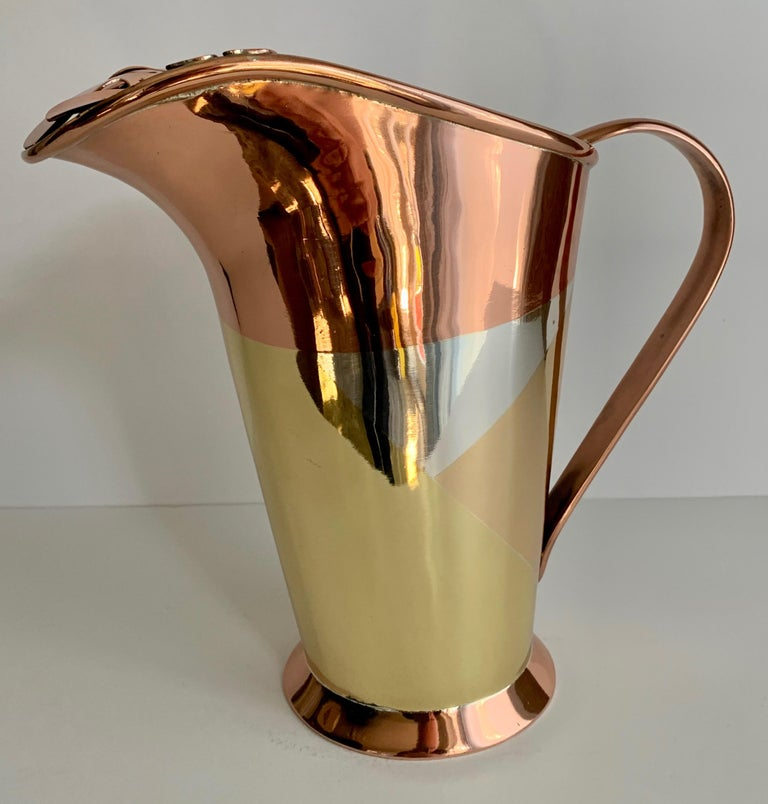 Multiple metal philodendron leaf handle Pitcher by Mexican Designer Los Castillo, Mexico - the pitcher is made of four metals that appear to be, Copper, Silver, Brass and Nickel. The Pitcher is a rare and handsome piece, perfect for drinks such as