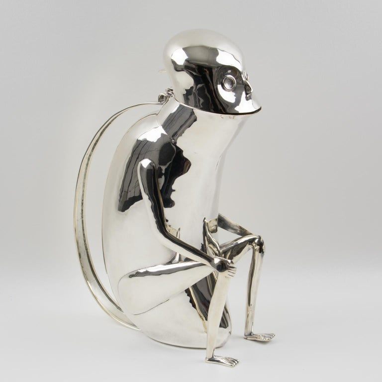 A fun whimsical silver plate metal lidded pitcher designed by Los Castillo, Mexico. Featuring a sitting monkey (sort of) in a very