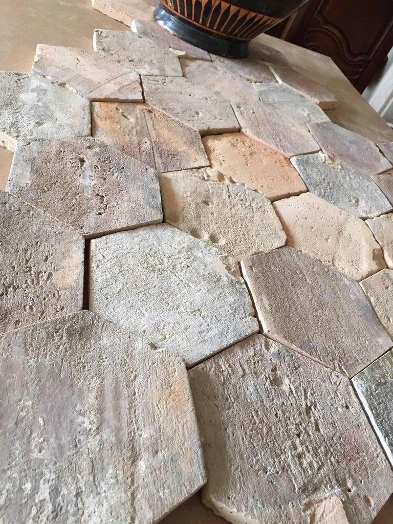 For a warm, rustic, Mediterranean look indoors or outdoors, look no further than our antique terracotta tiles. Crafted in France circa 1750, these Classic tiles are each a hexagon shape. The ceramic flooring has a geometric pattern and a discrete