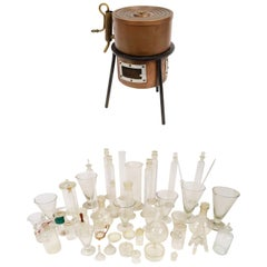 Lot of 46 Pieces of Glassware and a Copper Stove from a Milanese Laboratory