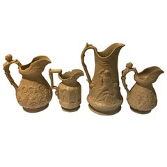 Lot of Four Mid-19th Century Relief Pitchers