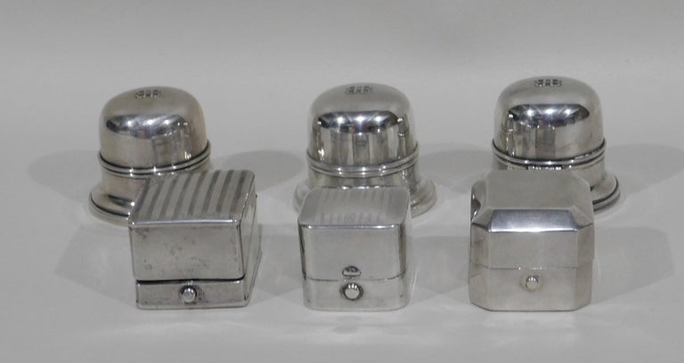Six sterling silver ring boxes, circa 1920 to 1930s. Three round Birks Toronto Canada measure 2 inches wide x 1.75 inches high and one square box is Birks measuring 1.75 x 1.75 x 1.25 inches high. Two other square boxes are stamped from England.
