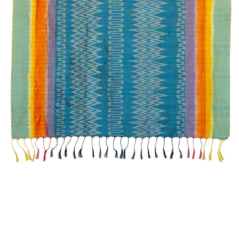 Handwoven 100% silk and Lotus Flower Plant detail adorn this silk scarf throw, handwoven by the weavers who live on floating homes on INLE LAKE, Myanmar. We visited the workshop many moons ago, and were stunned by the fine hand weaving skills and