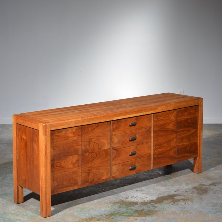 This is an amazing a very rare credenza by the great California designer Lou Hodges. Handcrafted in oak butcher block and walnut casing. In excellent condition. Makers mark located on the inside of casement door.
