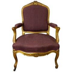 "Louis XV Cabriolet Armchair ""A la Reine"" in Gilded Wood"