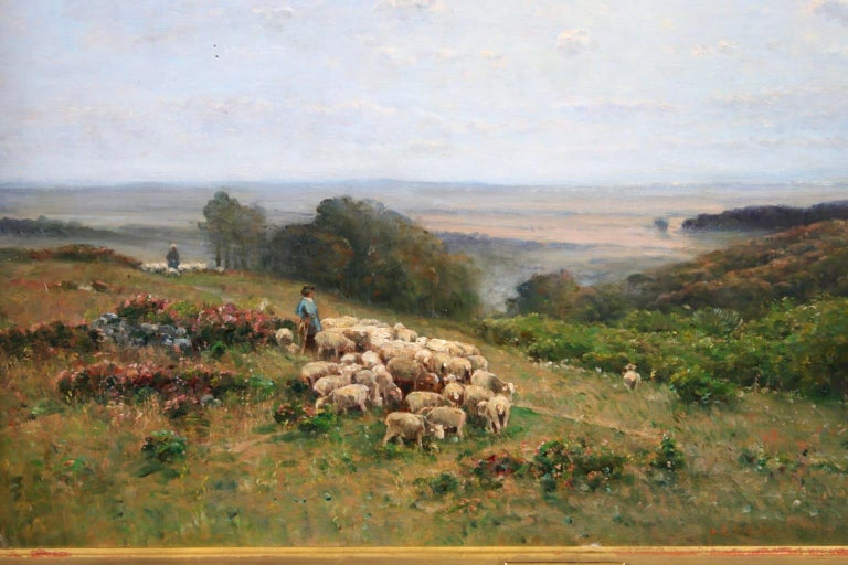 A beautiful oil on original canvas by French Barbizon painter Louis Aime Japy depicting shepherds with their flocks of sheep in a vast pastures.   Signature: Signed and dated 1886 lower right.  Dimensions: Framed: 40