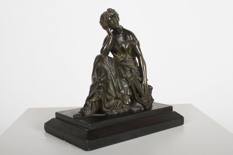 Neoclassical bronze by Louis Alfred Habert (French, 1824-1893) late 19th century figure of the muse: Terpsichore. Classical female seated, holding a Lyre and crowned with flowers on black marble base. Signed on the lyre