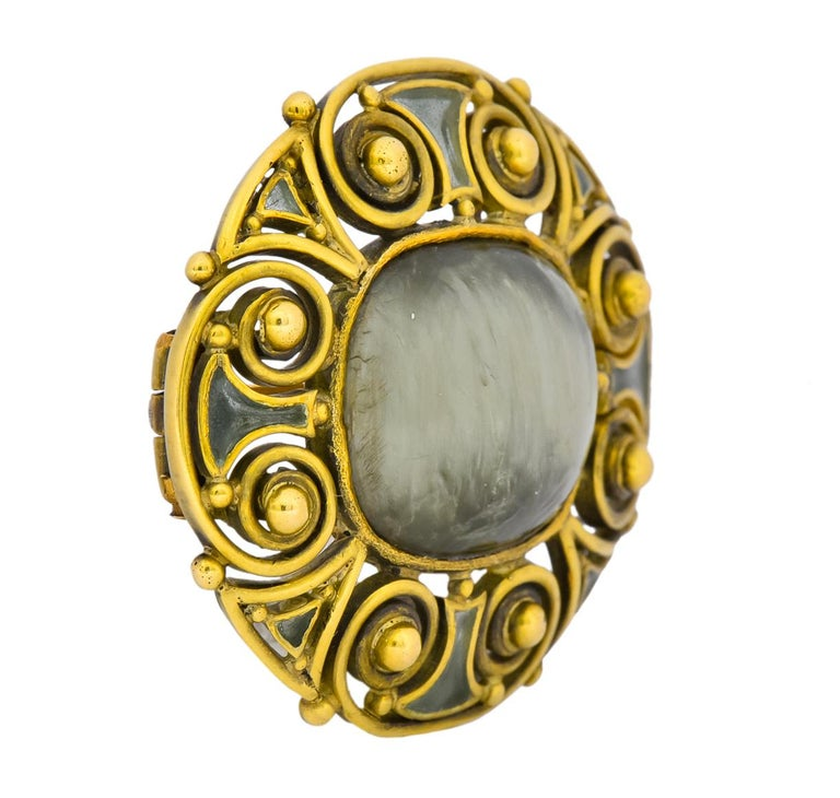 Louis Comfort Tiffany 1900's Arts & Crafts Hardstone Plique-A-Jour Enamel 18 Karat Gold LCT Brooch   Centering a cushion cabochon measuring approximately 14.0 x 12.0 mm, grayish-green in color with a fibrous opaque structure and strong