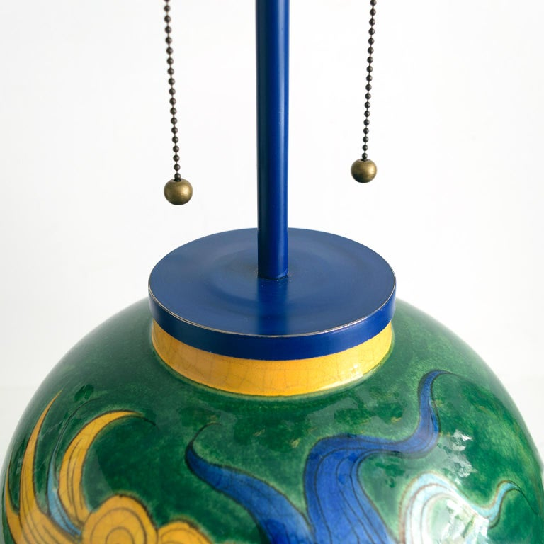 Louis Drimmer Ceramic Table Lamp with Blue & Yellow Faces on Green Body, France In Good Condition For Sale In New York, NY