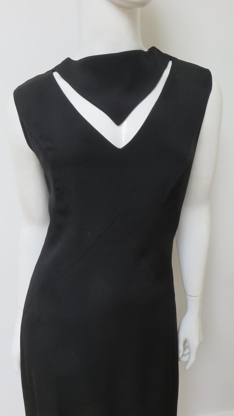 A fabulous little black dress from Louis Estevez.  It is a simple sleeveless A line dress with V cut out at the front neckline with some clever seaming enhancing the bust and waist. It is fully lined, and has a center back zipper. Fits sizes Small