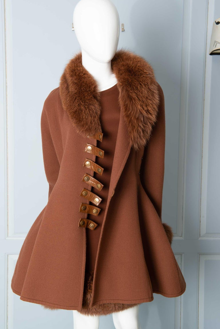 Haute Couture. Spectacular and timeless style. Similar to Christian Dior new look with the fitted waist and voluminous skirt of the coat. Also similar to Alaia skirt fullness. Cashmere coat has fox fur collar and cuffs. Silk dress has fox fur hem.