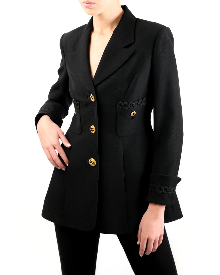 Louis Feraud vintage black blazer in wool Three oversized gold buttons running down the centre front in order to close the jacket  Two decorative buttons to two upper pockets on the right and left bust One gold button to each sleeve cuff Two