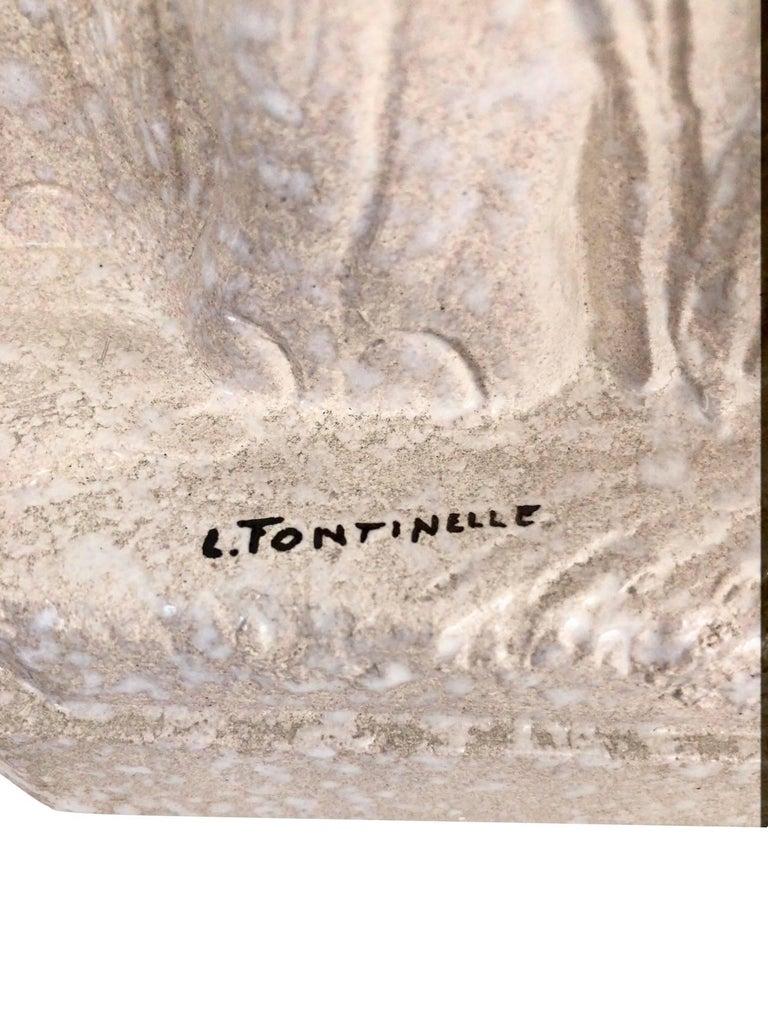 Cream glazed ceramic elephants by Louis Fontinelle (1886-1964). Signed: L. Fontinelle France, 1930s.  Dimensions: Width 51 cm Height 30 cm Depth 8 cm.
