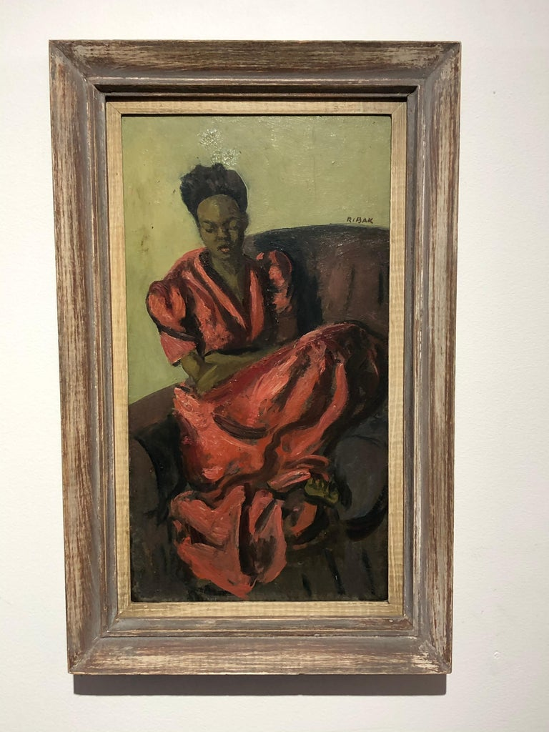 "Louis Leon Ribak oil on Masonite board , title "" Ruby in Red"" seated African American girl in red dress . In original frame with original label .painting size with out frame is 17.75 x 9.75 .