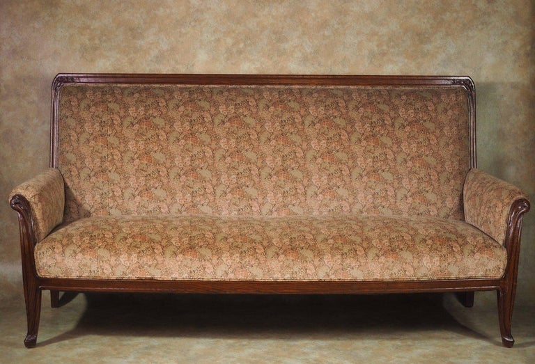 French Art Nouveau sofa in oak by Louis Majorelle, circa 1905. It is unusual to find a full-length Art Nouveau sofa and this good example by Louis Majorelle is correctly restored, refinished and reupholstered. The fabric is a re-issue by original