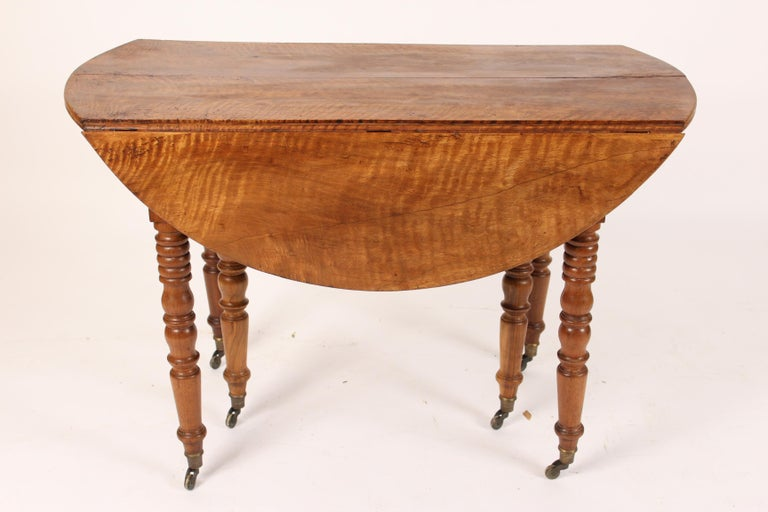 Louis Philippe tiger striped birch drop-leaf occasional or games table, circa 1840. The dimensions of the top when drop leafs are raised 45.5