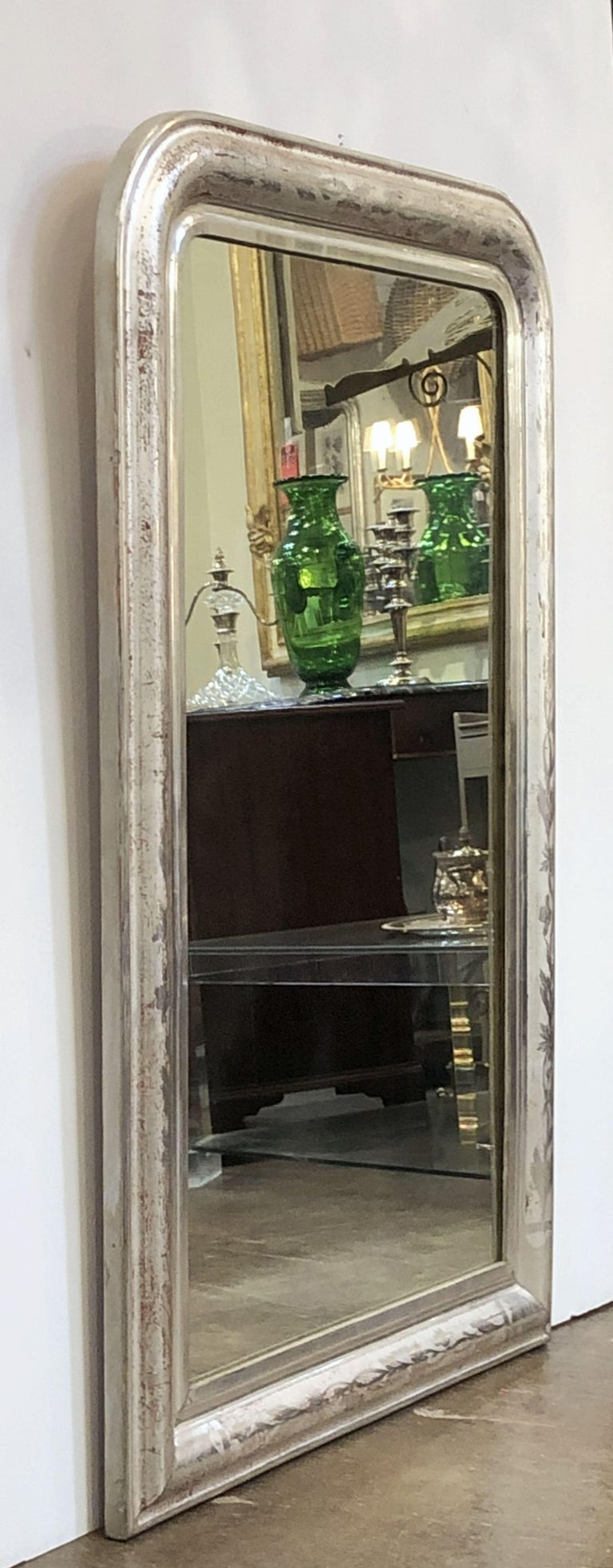 A fine large Louis Philippe wall mirror featuring a moulded surround with a beautiful patinated silver-leaf.  Dimensions: H 43 3/4 inches x W 29 3/8 inches  Other sizes available in this style.