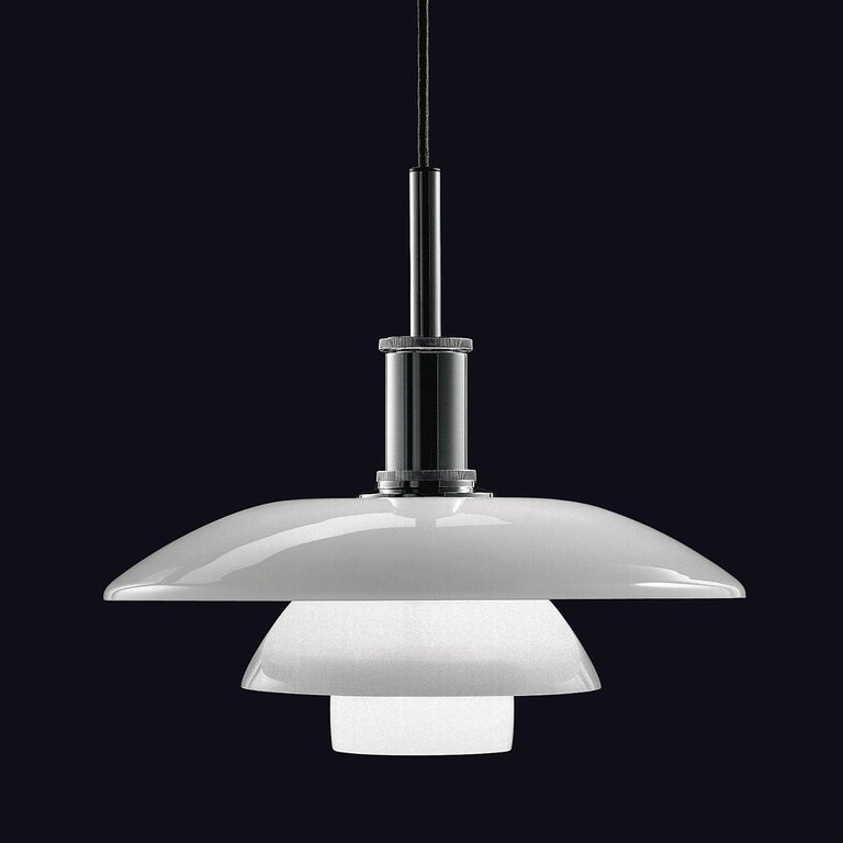 Louis Poulsen, large glass pendant light by Poul Henningsen. Width x Height x Length (mm) 450 x 410 x 450, 5.0 kg Material: Shades in mouth-blown white opal glass with the suspension unit in bright chrome plated aluminium. Canopy: Yes Cord