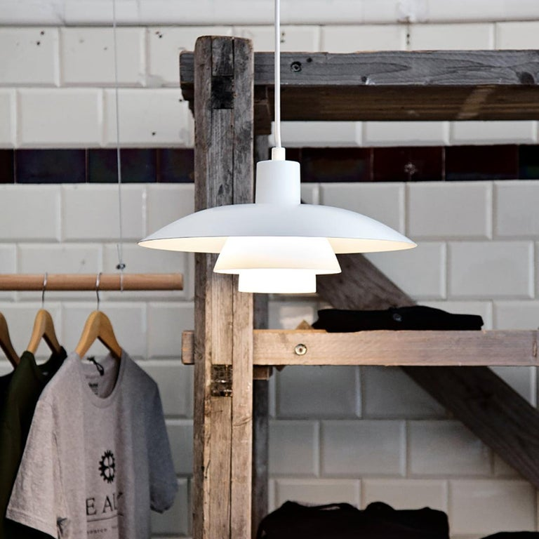 Louis Poulsen, large metal pendant light by Poul Henningsen. Measures: Width x height x length (mm) 400 x 200 x 400, 1.1 kg Material: White lacquered aluminium. Canopy: Yes Cord length: 3 m. Cord type: White fabric.
