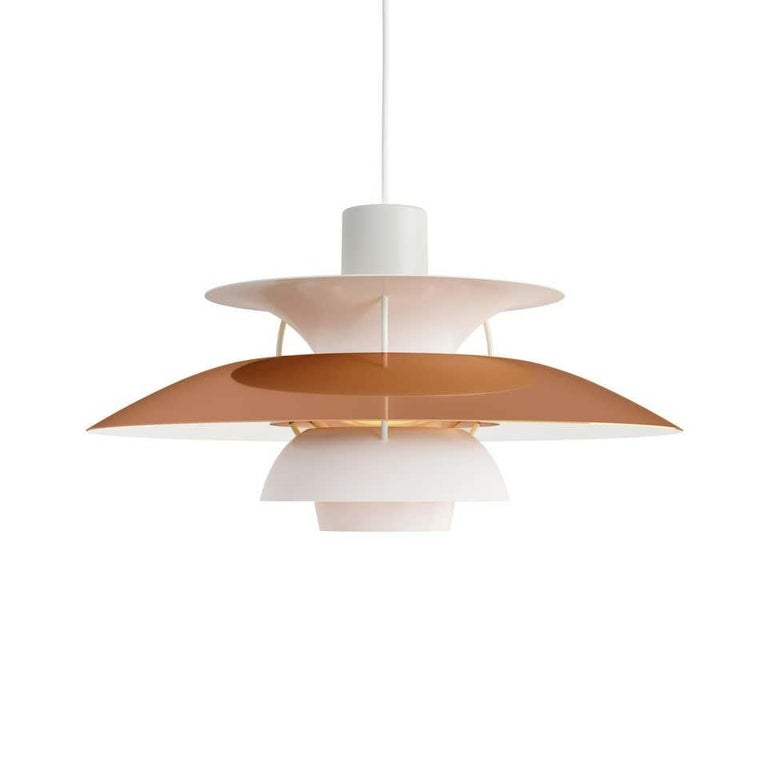 Louis Poulsen, medium metal pendant light by Poul Henningsen. Width x Height x Length (mm) 300 x 163 x 300, 2.0 kg Material: Polished copper or brass and white matt lacquered aluminium. Anti-glare shade: copper or brasse. Struts: white, rolled