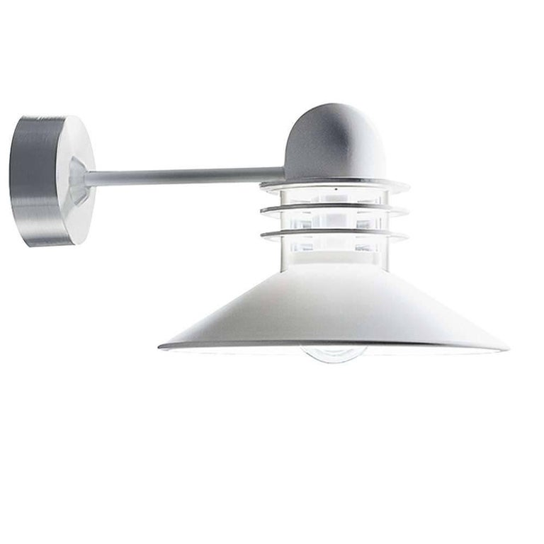 Louis Poulsen 'Nyhavn' white outdoor wall sconce. Designed by Alfred Homann and Ole V. Kjær in 1976 for lighting in old and heritage urban areas. The light is characterized by a cone-shaped shade and three anti-glare rings which emit soft light