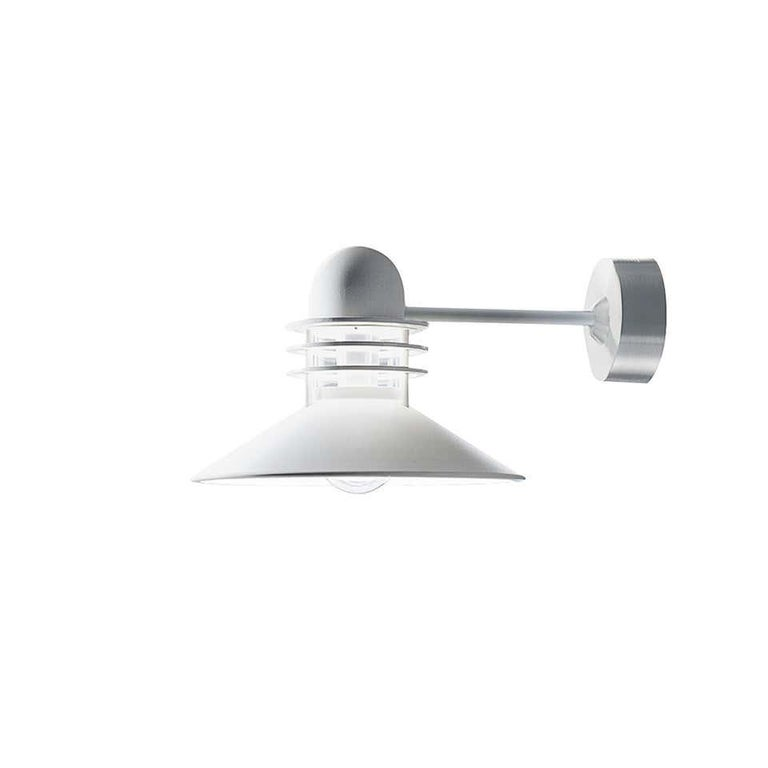 Louis Poulsen,outdoor wall lamp by Alfred Homann & Ole V. Kjær Size: 310 x 225 x 445, 4.1 kg Two colors:  Cooper color - 1820 euro White color - 1520 euro The conical shade ensures comfortable light that is directed downwards in a wide beam.