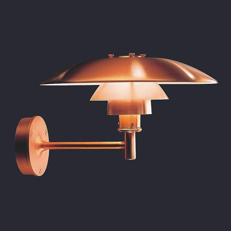 Louis Poulsen, outdoor wall lamp in cooper by Poul Henningsen Size: Width x height x length (mm) 450 x 290 x 505, 6.8 kg Shades: Spun copper. Wall box and arm: Copperplated, brass. Please note that the copper surface is untreated in order to