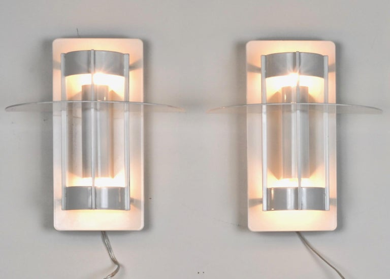 We have five of this modern Classic sconces available. Each newly wired, replacing original florescent fittings with incandescent lights. Single bulbs facing up and down. Very nice quality fixtures. Powder-coated in gloss white. Price listed is per