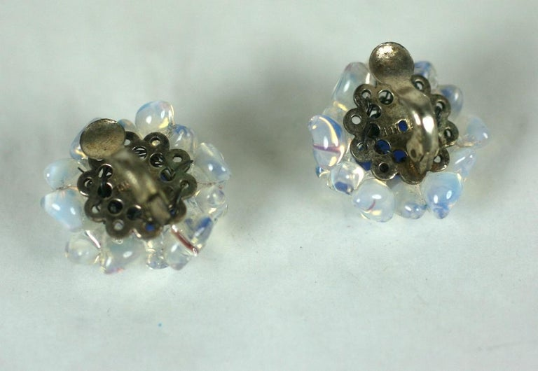 Charming Louis Rousselet  button ear clips of hand made faux sapphire cabocheons  and opal flower buds in pate de verre. Sllver plate clip back fittings. Excellent Condition, Marked Made in France.   L .75