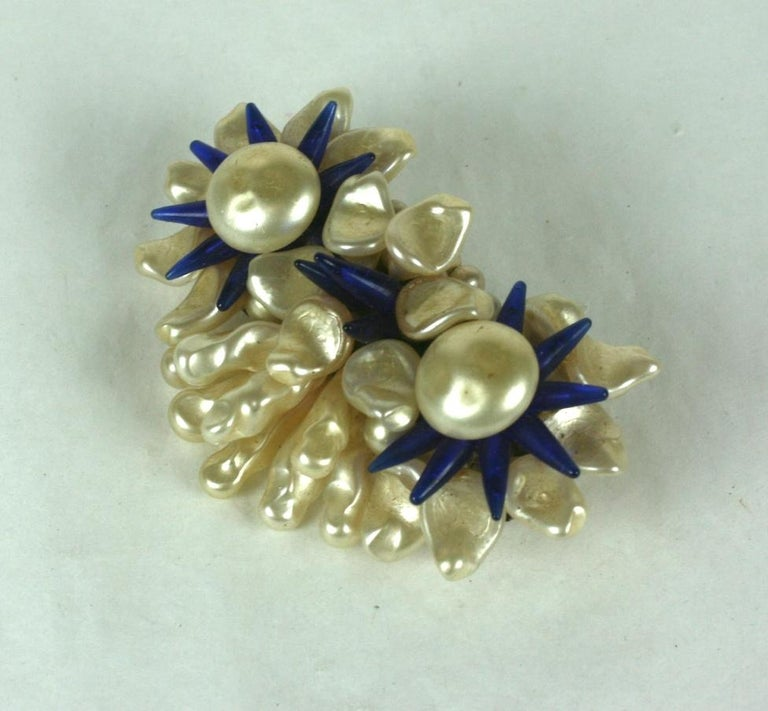 Louis Rousselet triple flower head brooch of signature hand made and hand wired nacre button cabochons, petals and leaves with deep sapphire stamens of pate de verre. Gilt metal findings and clasp. Handmade.  Excellent Condition. Old Stock, Signed