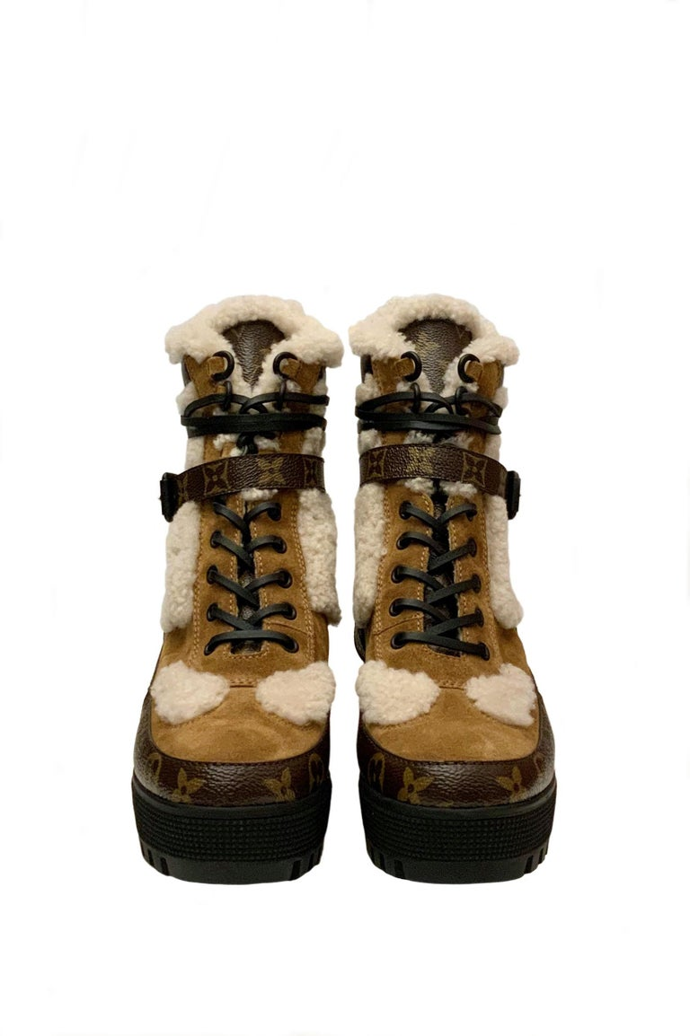 A star of the Louis Vuitton shoe collection, the Laureate platform desert boot is revisited in a winter look! It is combining tan suede calfskin leather with natural color shearling.  It features Monogram-canvas trim and leather laces. The sole and