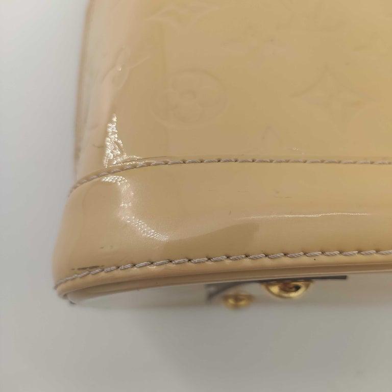 LOUIS VUITTON Alma Handbag in Beige Leather 9