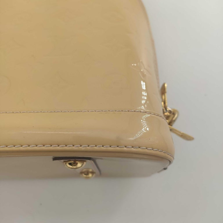 LOUIS VUITTON Alma Handbag in Beige Leather 10