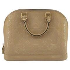 LOUIS VUITTON Alma Handbag in Beige Leather
