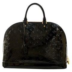LOUIS VUITTON Alma Handbag in Blue Patent leather