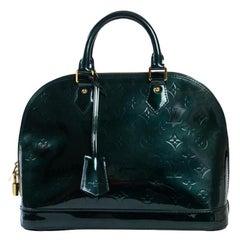 LOUIS VUITTON Alma Handbag in Green Patent leather