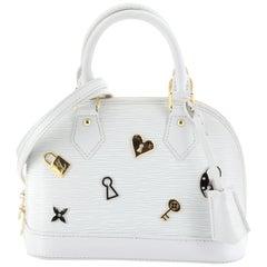 Louis Vuitton Alma Handbag Love Lock Epi Leather BB