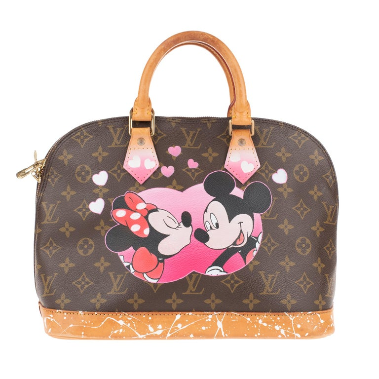 The iconic Louis Vuitton Alma Bag in Monogram canvas, smooth natural cow leather trim, brown textile lining, golden cladding, 2 handles in natural cow leather allow a hand or elbow hold. This bag was customized