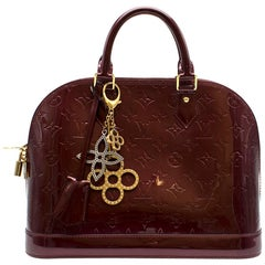 Louis Vuitton Alma PM Leather Bag W/ Tapage Charm