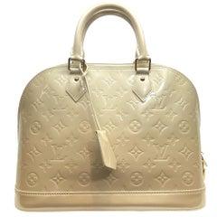 Louis Vuitton Alma Vernis PM Monogram Top Handle Handbag, France 2011.