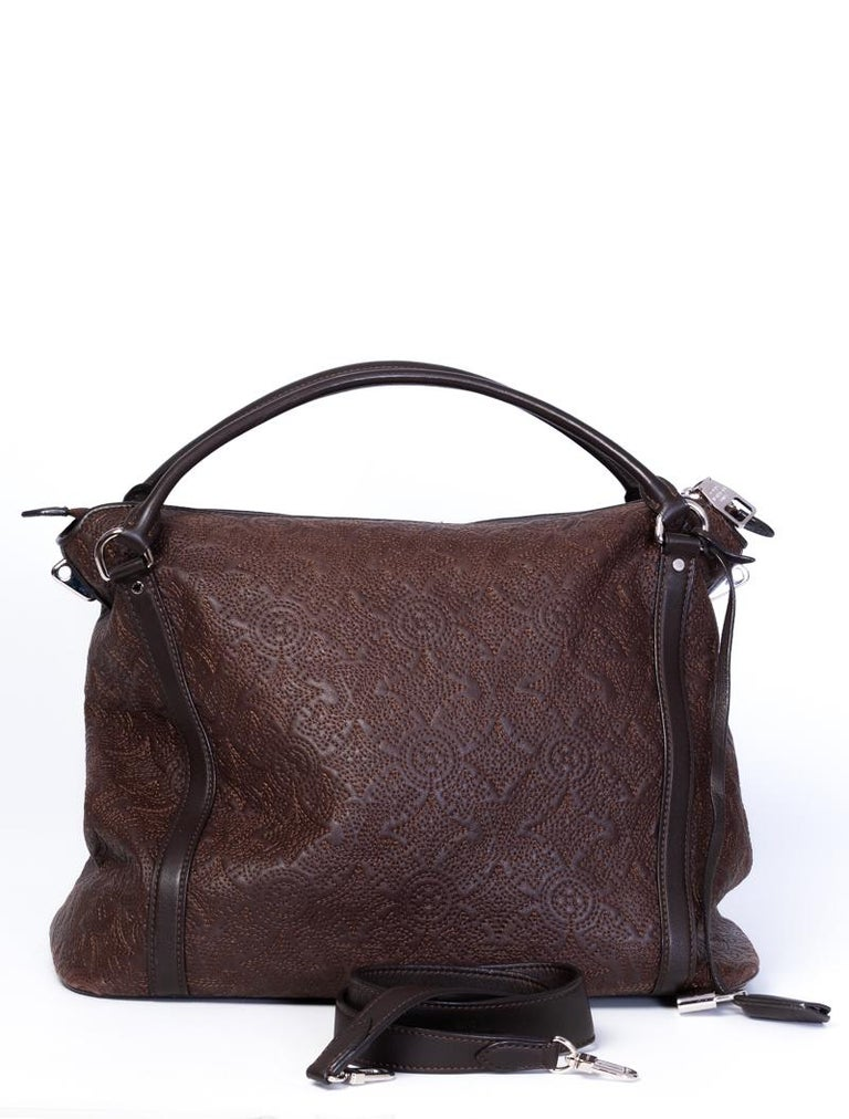 This bag is made of brown soft lambskin Antheia leather and embroidered with an ornate version of the monogram print. Featuring rolled leather handles, a long leather key/lock holder, sliver tone hardware, top zip closure, chocolate alcantara